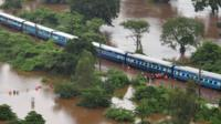 Aerial view of a stranded Indian train in a flooded area between Badlapur and Vangani following monsoon rains, 27 July