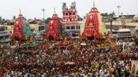 Devotees gather near the chariots in Puri, Orissa, in India