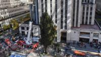 Christmas tree put into place outside Rockefeller Center