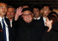 Kim Jong-un waves at the Marina Bay Sands hotel in Singapore (June 11, 2018)