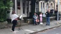 people playing instruments in street