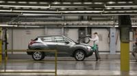A worker with a Nissan Juke at the factory in Sunderland