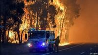 A handout photo taken on January 7, 2016 and released on January 8 by the Department of Fire and Emergency Services shows firefighters battling a fire at Waroona in Western Australia