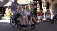 Women ride on bike