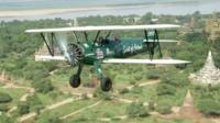Tracey Curtis-Taylor in her bi-plane over Asia