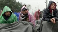 Migrants wait at the Idomeni border crossing in Greece