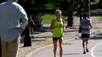 Female runner in yellow top in Central Park