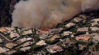 The blaze surrounded parts of an affluent Los Angeles neighbourhood, home to some Hollywood stars.