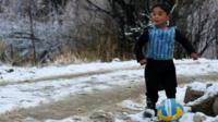 Murtaza Ahmadi, 5, wears a plastic bag jersey as he plays football in Jaghori district of Ghazni province
