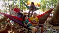 People relax in hammocks outside of Cuba Libro.