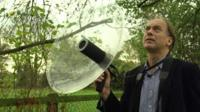 Peter Cowdrey using a parabolic reflector microphone to capture birdsong