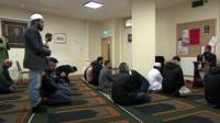 Muslims at prayer in a Christian church