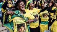 Mourners gather at the Olando Stadium in Soweto, outside Johannesburg