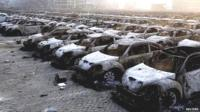 Damaged cars at the site of the blast in Tianjin, China