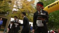 Waiters taking part in the Waiters' Race Japan held in Yokohama on Monday 23 November 2015