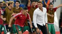 Morocco's players celebrate behind coach Herve Renard