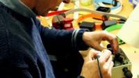 Man making a gadget