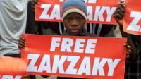 Child carrying 'Free Zakzaky' sign