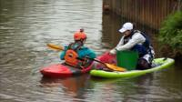 Canoeists pick litter on the River Medway