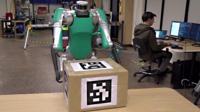 A robot holding a box