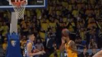 Jordan Mickey scores a basket with his head