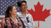 Graphic of Robin and Heather Vargas in front of the US and Canada flags