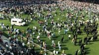 ambulance on crowded pitch at Hillsborough