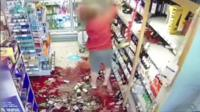 Wine being knocked from shelves