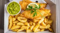 Fish and chips with peas and slice of lemon and garnish