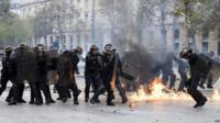 A petrol bomb explodes next to French riot police on the Place de la Republique, Paris, on 15 September 2016