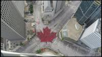 "Thousands gather to create ""largest living maple leaf"""