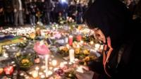 People gather and light candles during a vigil to pay tribute to the victims of the attacks in Brussels, Belgium. 22 March 2016