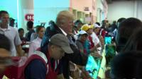 Donald Trump handing out food aid