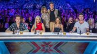 The new look X Factor 2015 team, presenters (back row) Caroline Flack and Olly Murs with judges (left to right) Nick Grimshaw, Rita Ora, Cheryl Fernandez-Versini and Simon Cowell.