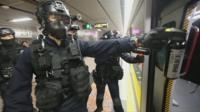hong kong police storm metro