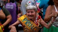 "Revellers take part in a street carnival parade of the ""Loucura Suburbana"" in Rio de Janeiro, Brazil"