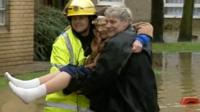 Woman rescued from flood