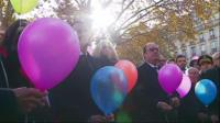 French President Emmanuel Macron and ex-President Francois Hollande release balloons