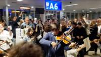 Violinist playing in an airport