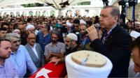 Turkish President Recep Tayyip Erdogan addresses the crowd after the funeral service for victims of the thwarted coup