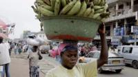 Woman carrying bananas on her head