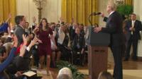 A White House staffer tries to grab CNN correspondent's microphone