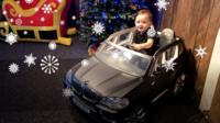 Reggie with miniature BMW X5