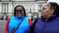 Two women outside Buckingham Palace