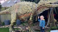 A boy and dinosaur