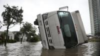 A truck is seen on its side after being blown over as Hurricane Irma passed through on September 10, 2017 in Miami, Florida.