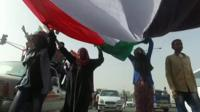Anti-government protesters gathered on Thursday as Sudanese waited for the army to make a statement.