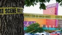 Crime scene tape near Century 16 cinema