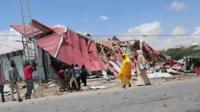 Collapsed buildings after the convoy attack in Mogadishu