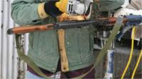 A gun gets sawn in half